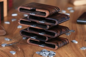 Stacked wooden wallets showing capacity